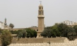 The clock tower of Qushla is seen at noon in central Baghdad